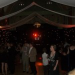 Tewin Memorial main hall transformed using hired drapes and lighting