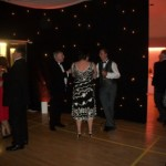 Hired drapes with embedded lights creates a party atmosphere at Tewin Memorial Hall