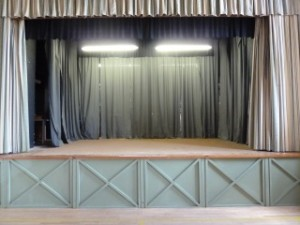 The Stage at Tewin Memorial Hall with lighting on