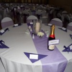 Purple themed wedding reception at Tewin Memorial Hall