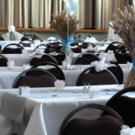 Tables decorated for a wedding in Tewin Memorial Hall